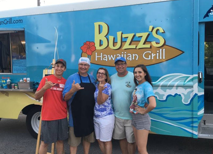 Buzz's Hawaiian Grill owner Thomas Moore (second from left) launched his food truck in June.