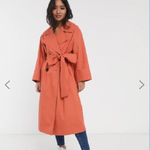 ASOS DESIGN Petite double breasted lightweight trench in teracotta - Best Trench Coats for Petites: Falls Loosely Over the Body