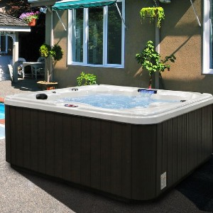 American Spas 6-Person 30-Jet Hot Tub with Backlit LED Waterfall - Best Hot Tubs Under $5000: Hot Tub with Ozonator System