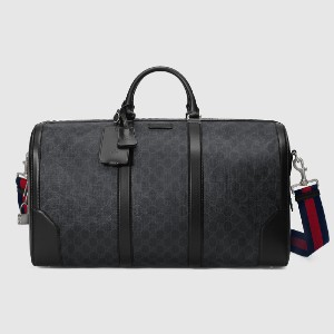 Gucci GG Black carry-on duffle - Best Designer Duffle Bags: Interior Zipper and Smartphone Pockets