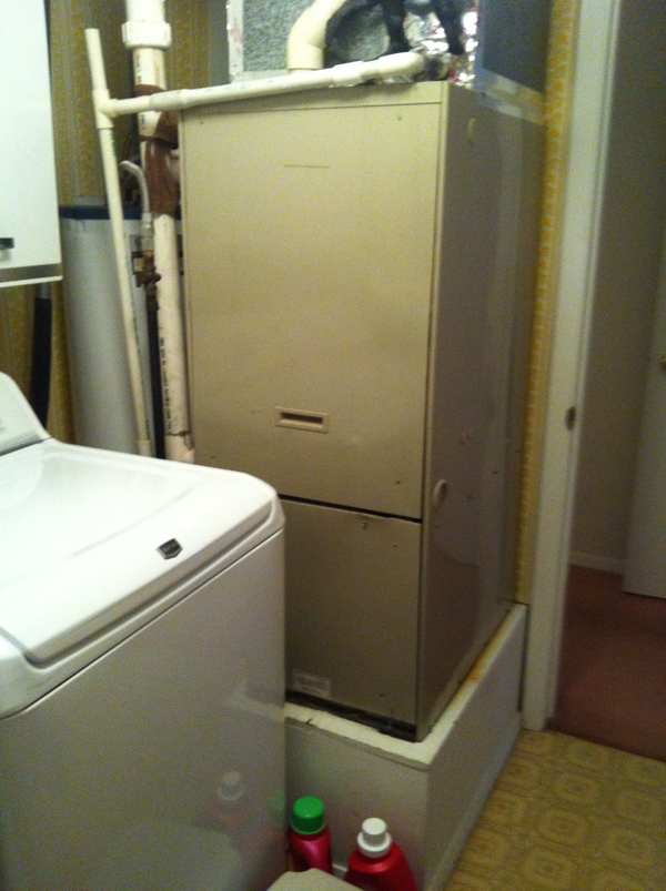 Before - Old Furnace and Water Heater