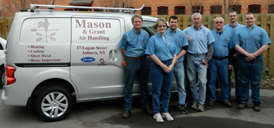 company team photo in front of company vehicle
