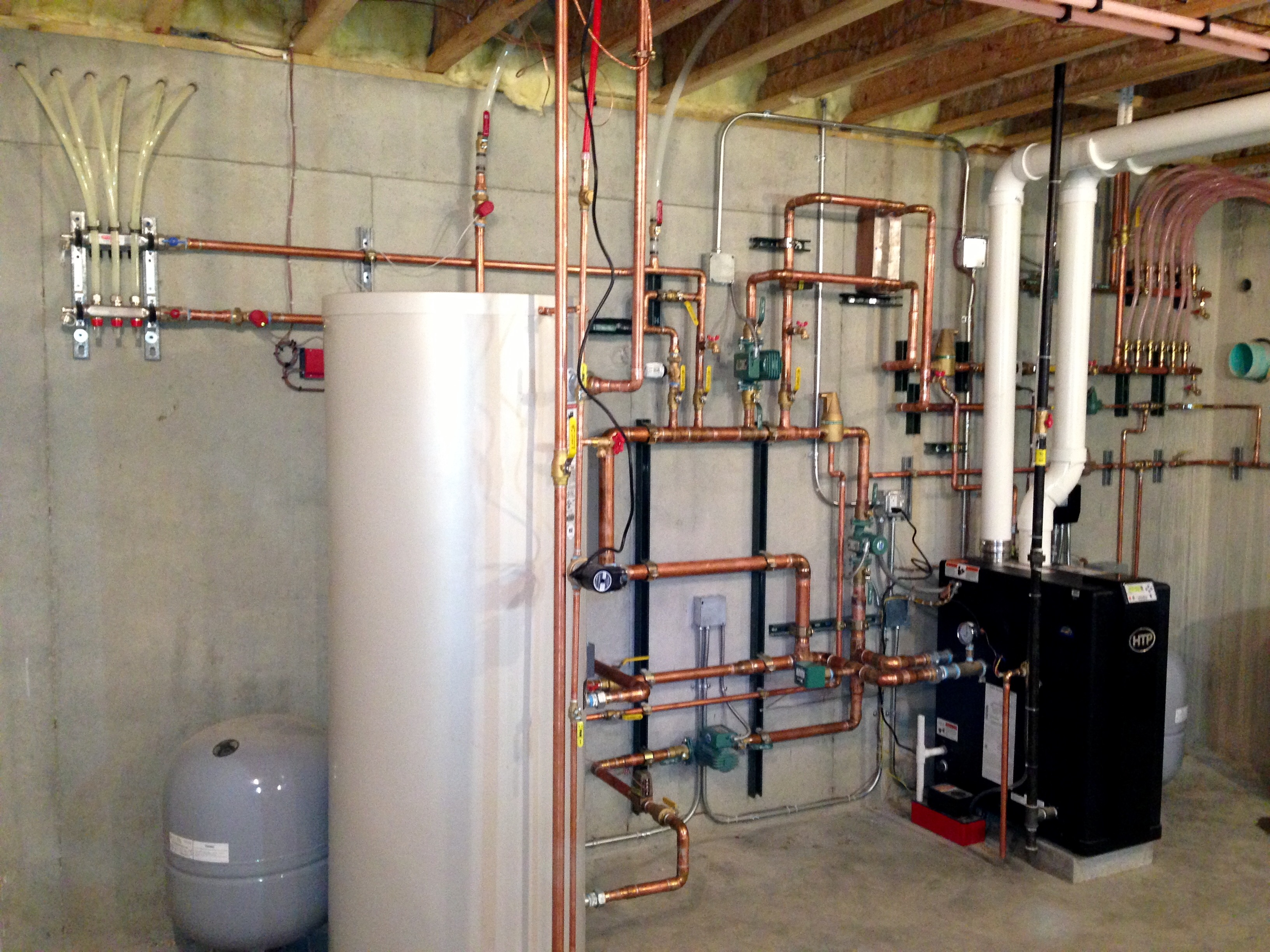 Boiler System with Driveway and sidewalk snow melt, Radiant floor heat and Residential Hot Water