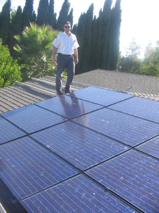 Our owner John inspects a recent solar installation
