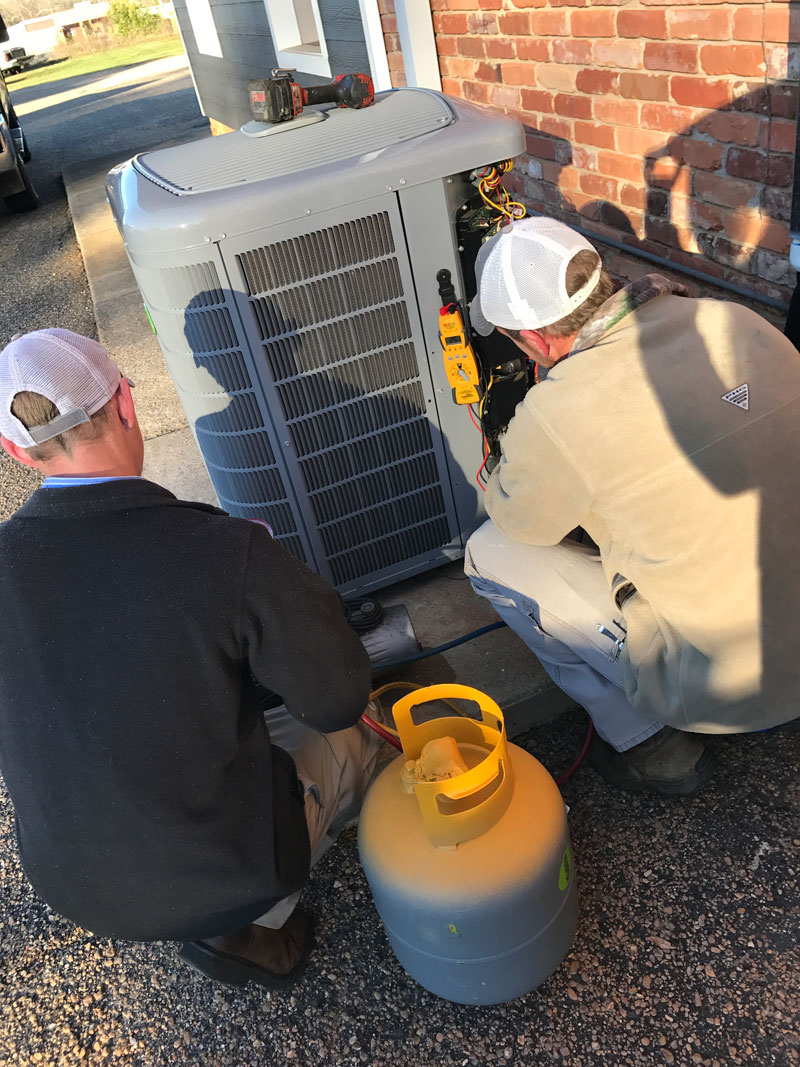Installers Checking Pressure on New Unit