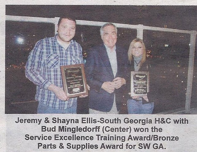 newspaper article showing company with awards won for the Service Excellence Training Award/Bronze Parts and Supplies Award for SW GA