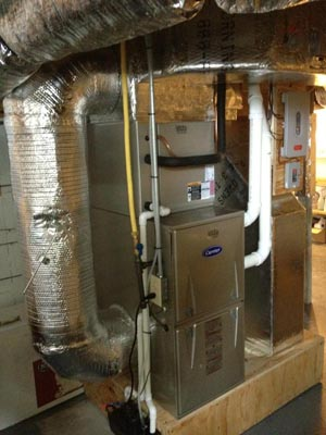 Carrier 92% natural gas furnace with heat pump and Honeywell zoning package