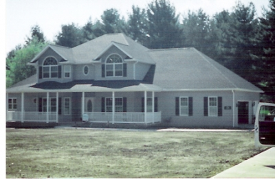This home is located outside of New Philadelphia in site of Green Valley Golf Course. This picture was taken across the road to allow a better view of this beautiful home. Take notice during your next trip to the course. You will be pleased with the quality of construction put into this home. (Picture taken before landscaping matured and/or completed.)