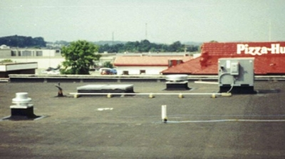This is a picture of an actual rooftop where Simpson Heating and Cooling installed a packaged heating and cooling system plus the fresh air ventilation system beside the Pizza Hut in Canton, Ohio.