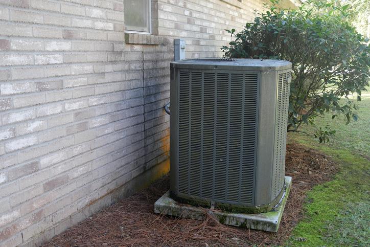 man repairing an air conditioning unit