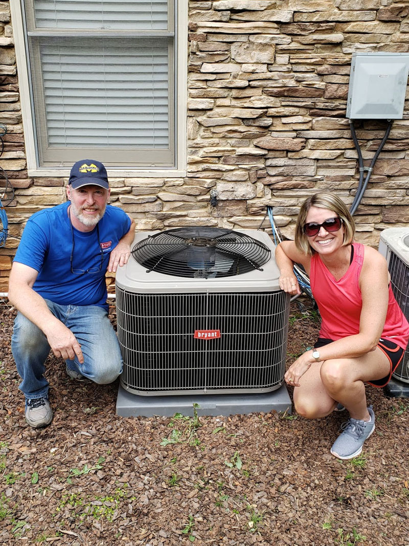 A happy customer comes home to see her new AC is ready to go.