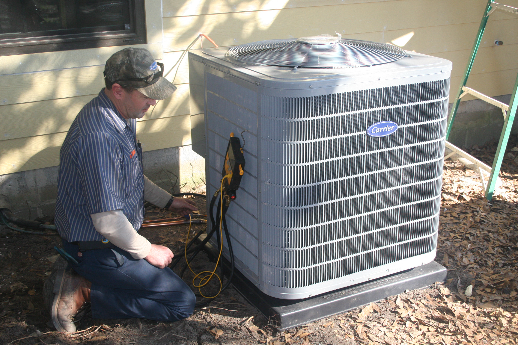 Carrier Heat Pump, Outdoor Unit<br>Installing outdoor unit of new 16 SEER, two stage Carrier heat pump</br>