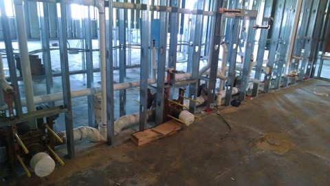 Commercial restroom plumbing above slab rough in
