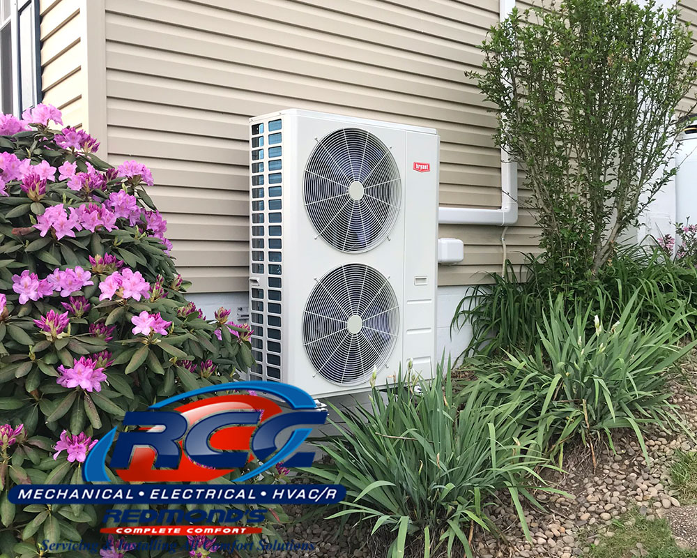 Bryant ductless heat pump outside tan house near Howard and Avis, PA