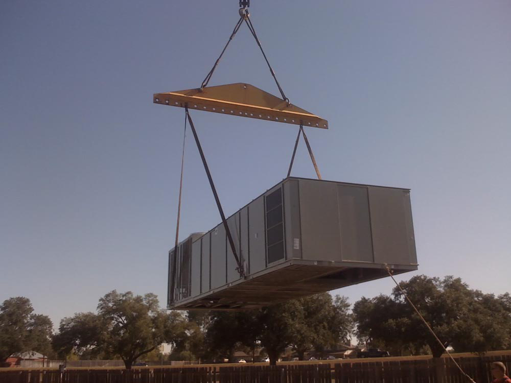 Large Rooftop Packaged Unit Being Lifted Into Place