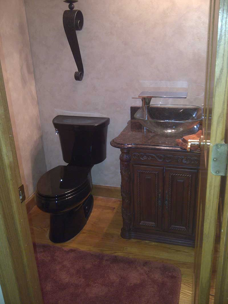 Custom Kohler Black toilet with custom vanity install