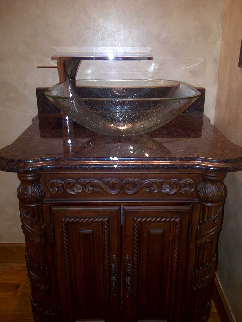 Custom vanity, custom granite top, Deco Lav vessel glass bowl and a Hans Grohe Axor lavatory faucet