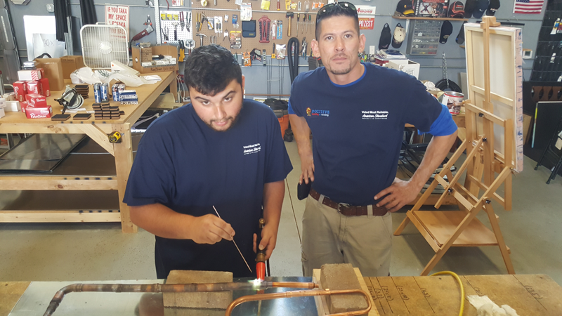 Brandon (left) and Chris (right) Working in the Shop