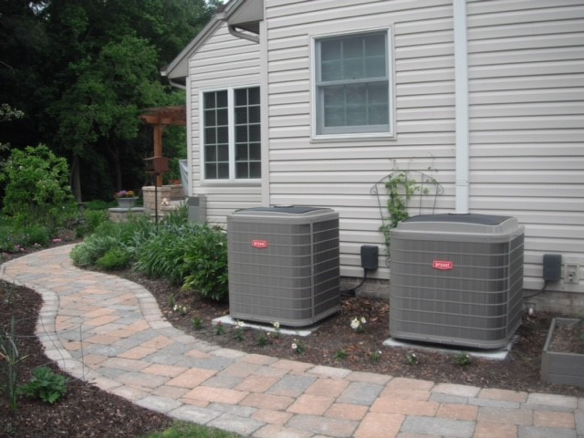20 SEER Extreme Heat Pump with line cover to the attic.