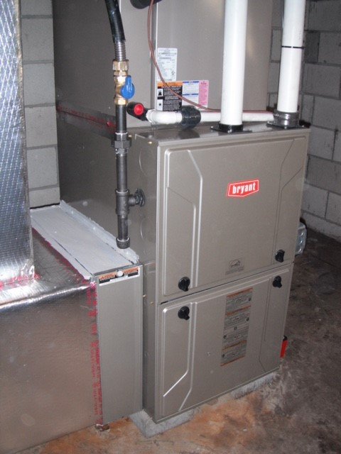 Bryant 987 modulating gas furnace in a basement with Bryant Media air filter