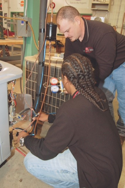 A.C. Scott working with a VoTec student