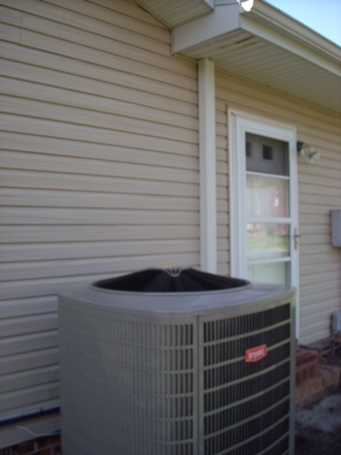 Bryant 286 Heat Pump with line cover to the attic