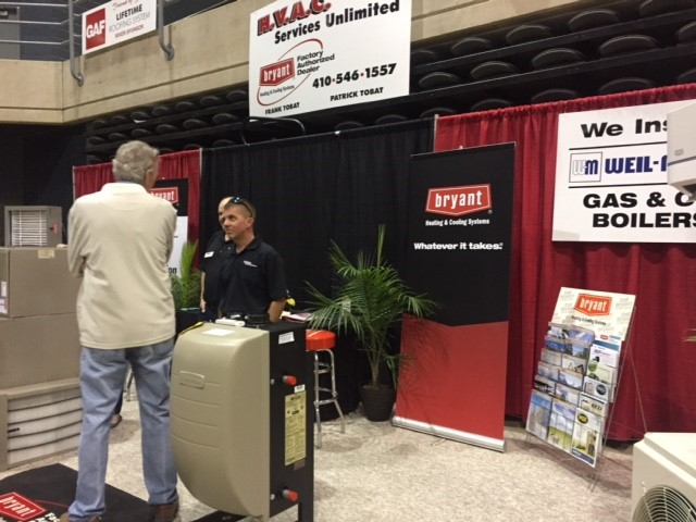 Pat Tobat speaking with a customer at the Salisbury Home Show