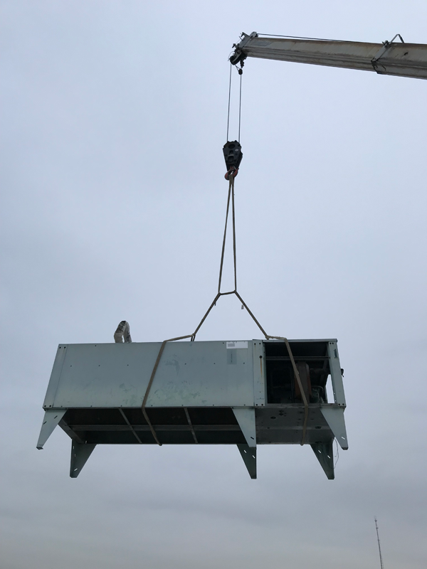 Removing Old Unit With Crane