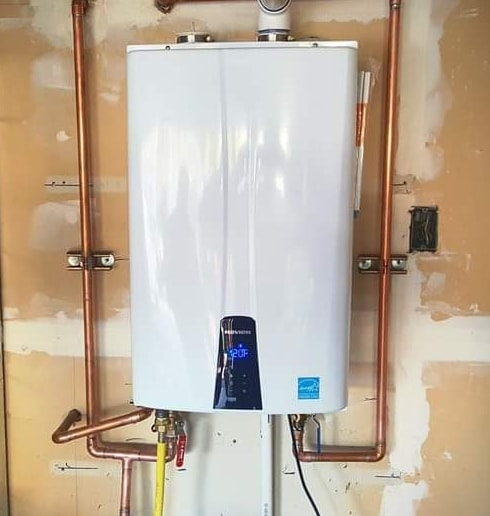 Tankless water heating unit installed by A Quality Plumber