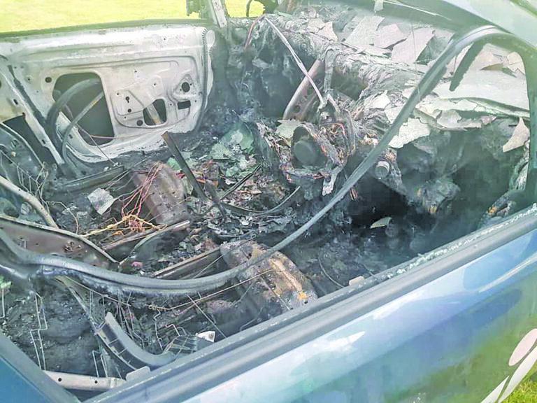 Destruction of nurse's car branded an 'attack on community'