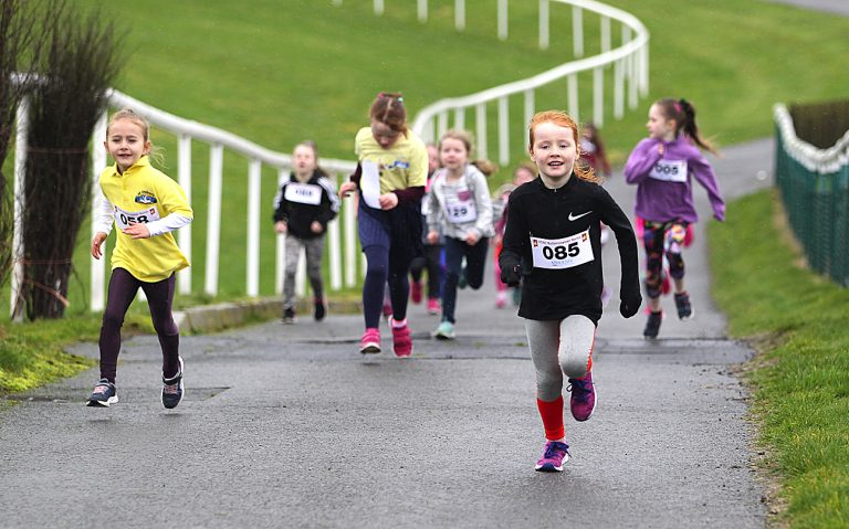 Children gallop round the racecourse as East Down Athletic Club stages its Rollercoaster races