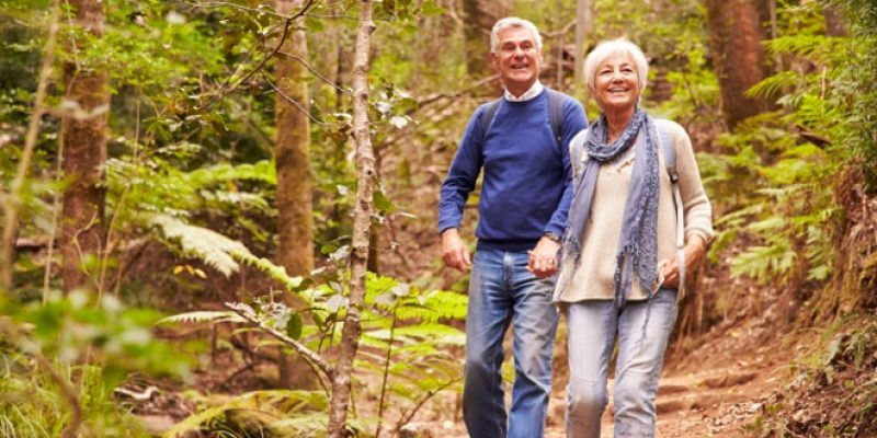 Mature couple walks in woods