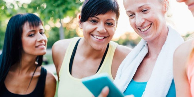 Women looking at smartphone