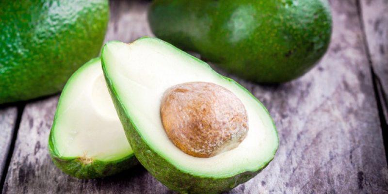 Fresh cut avocado on wood surface
