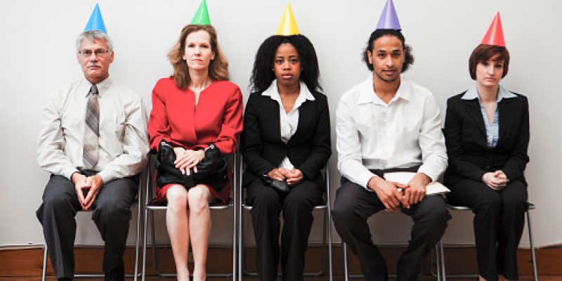 A group of business colleagues sitting awkwardly at an office party