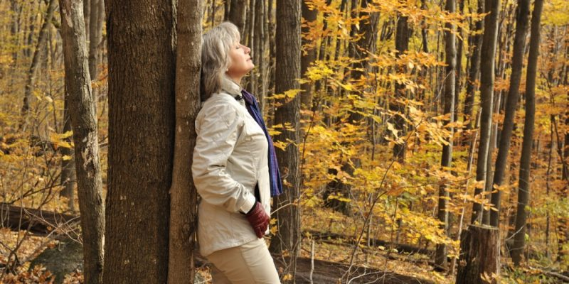 Woman breathing in forest