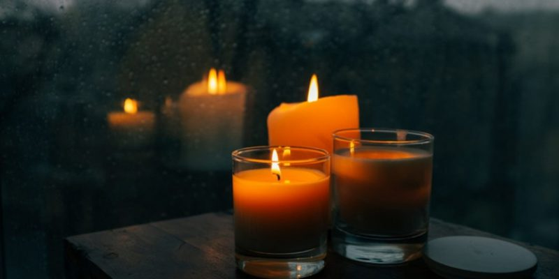 candles lit on a dark fall night