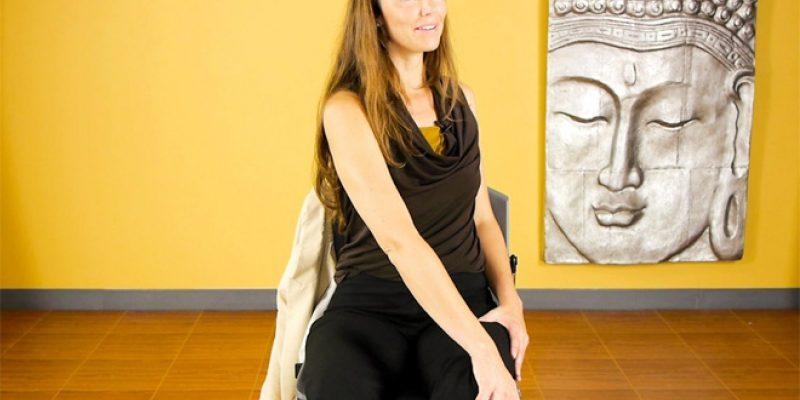 Woman demonstrating chair yoga pose