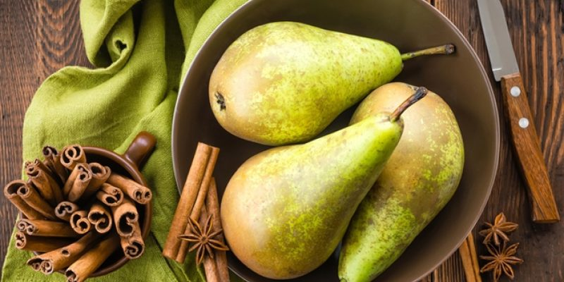 Pears and cinnamon on table