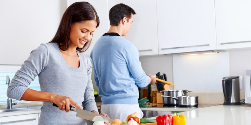 Couple cooking with onions