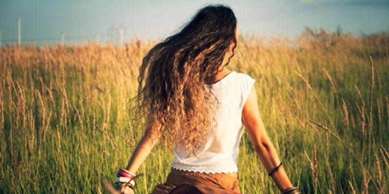 Woman running free in field