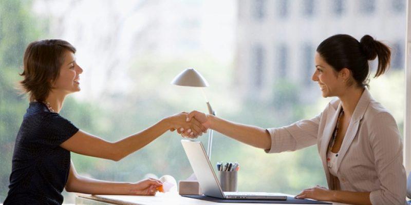 Two businesswomen shaking hands