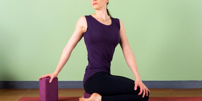 Woman in seated twist yoga pose