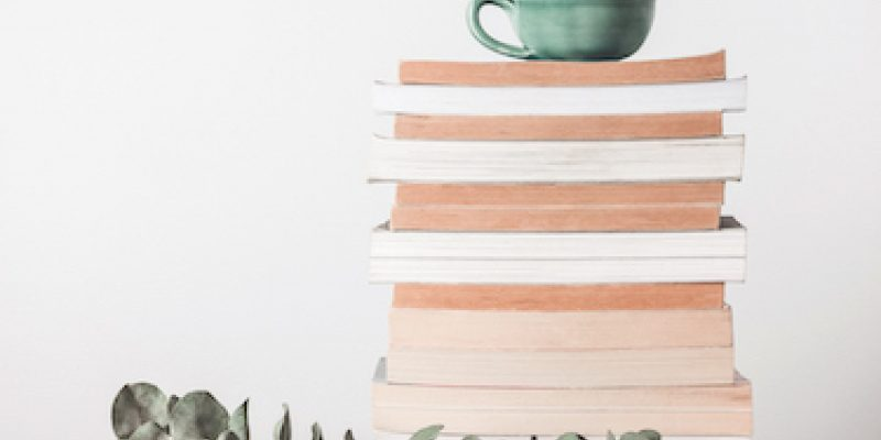 Stack of books and eucalyptus branch