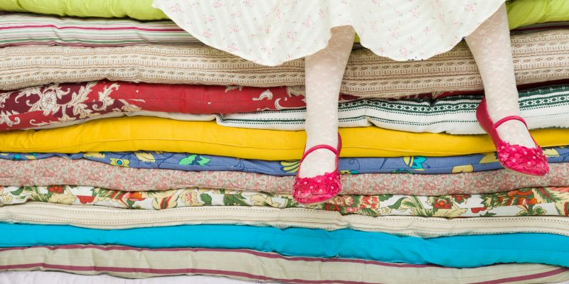 Person with insomnia seeking ways to sleep better, like the Princess and the Pea story.