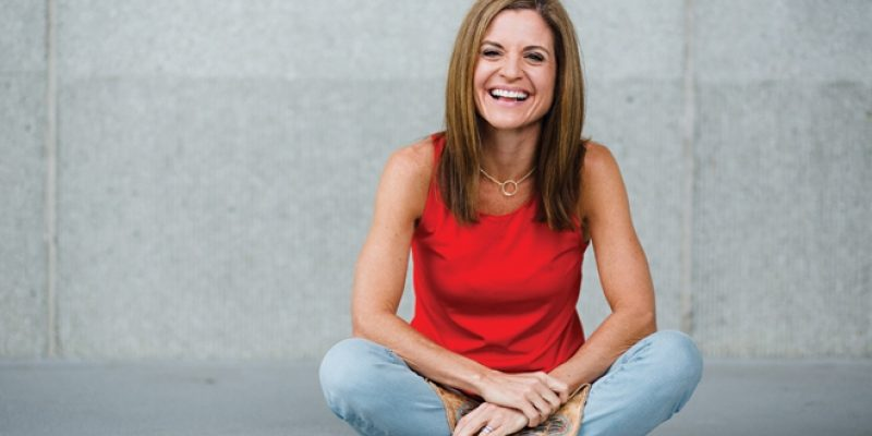 Image of Glennon Doyle Melton wearing red shirt and cowgirl boots