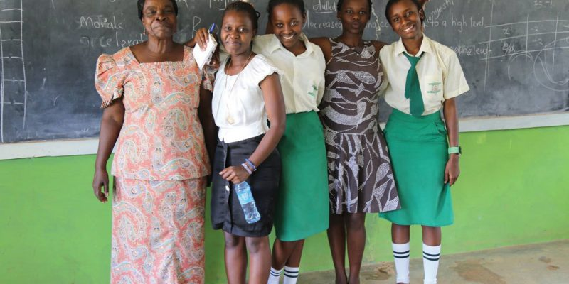 Teacher and students at Glory Value School