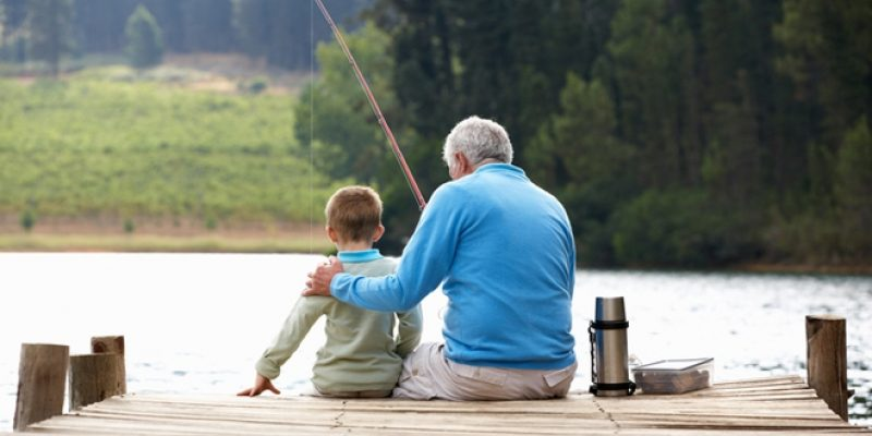 Grandpa fishing with son