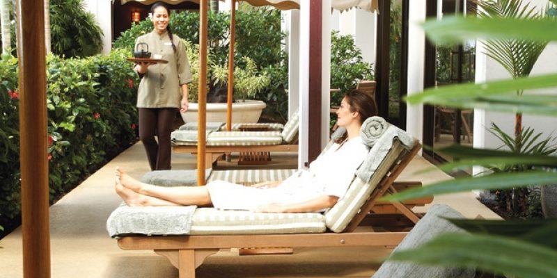 Woman in lounge chair at Halekulani Hotel
