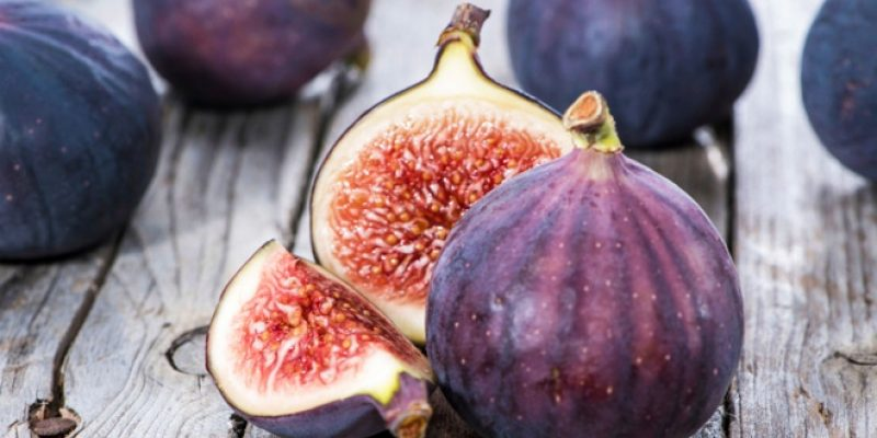 Fresh figs on wood surface